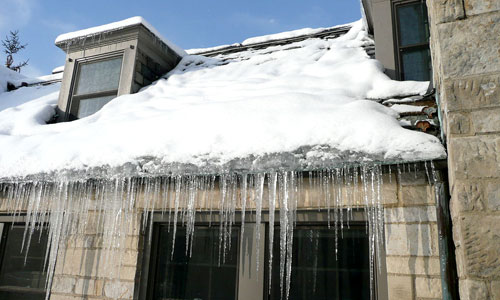 Ice dam on a home in winter