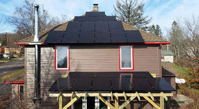 Solar panels adorn the roof of Jay and Rose Arrowsmith DeCoux's Art House Bed & Breakfast. The couple is the first in Grand Marais who will be able to generate solar power and sell power back to the grid