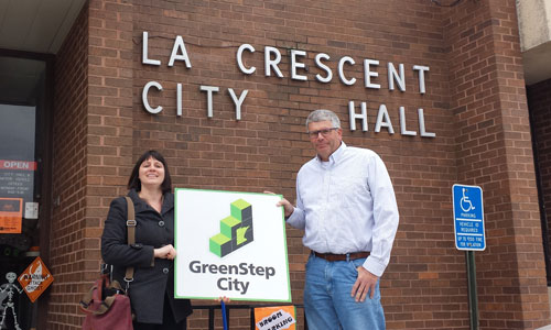 La Crescent receives their GreenStep City sign from EQB staffer Kristin Mroz