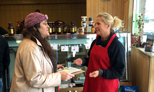 Diana McKeown with Metro CERT talks to a Chisago business owner about energy efficiency