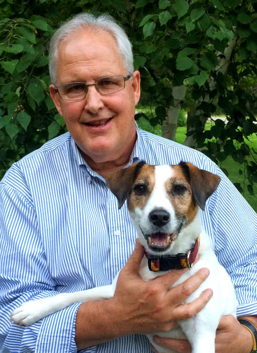 Executive Director Jim Clark and Maddie the dog