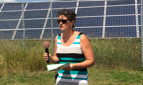 Leech Lake Environmental Deputy Director Brandy Toft speaks at an unveiling ceremony Monday in Prescott for newly built solar arrays across the Leech Lake reservation. Photo by Matthew Liedke at Bemidji Pioneer