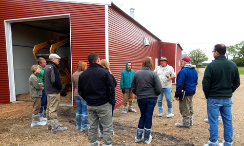 Touring the biomass-heated poultry barn at Viking Company