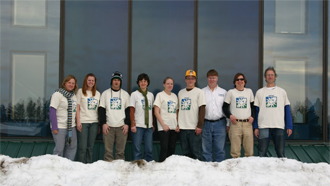The crew at RREAL in Pine River stands in front of their solar air heat collecto