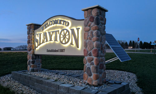 New solar-powered LED lit signs welcome people to Slayton