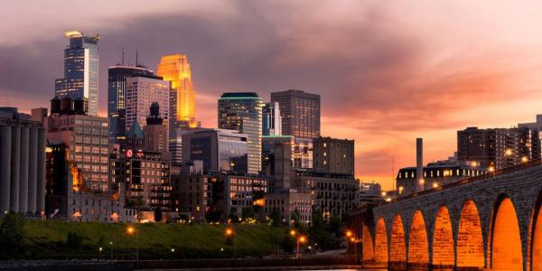 Minneapolis Downtown and the Stone Arch Bridge at Sunset