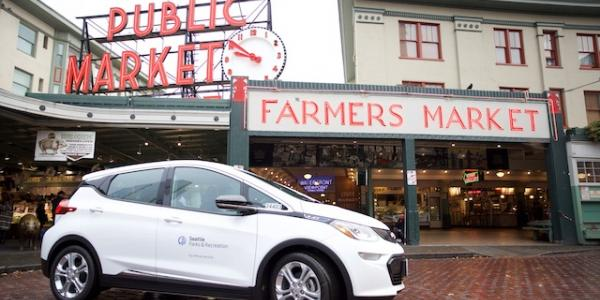 Electric car parked in front of Public Market in Seattle