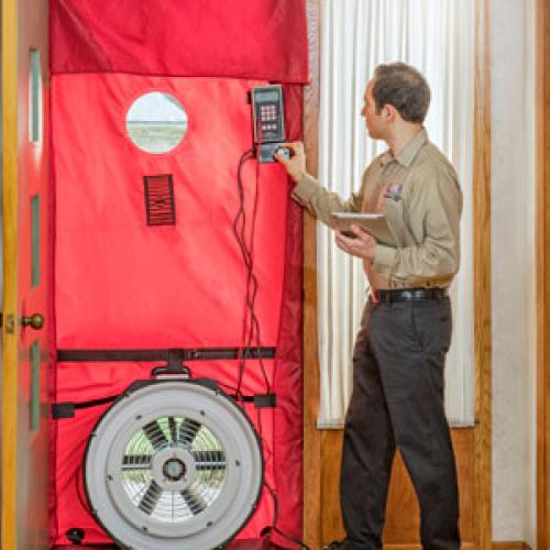 Blower door test to find leaks during energy audit. Photo courtesy Home Energy Squad