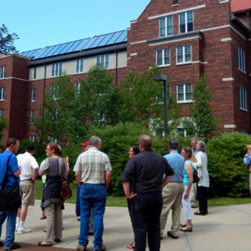 Touring solar installations at Carleton College before learning about community solar opportunities