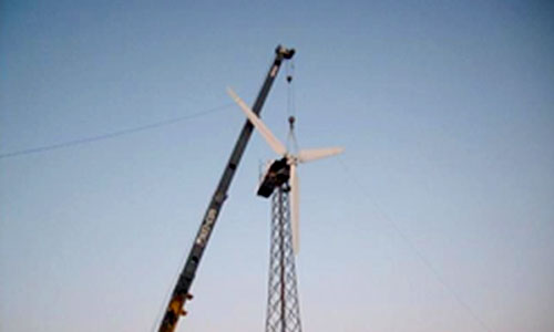 Small wind turbine being installed